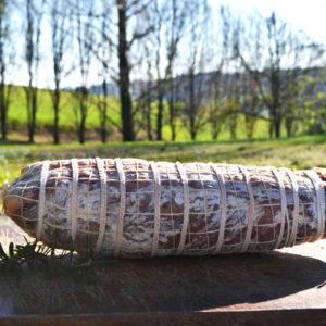 Coppa in primo piano con sfondo di natura - salumi Piemonte - Agrisalumeria del Bosco